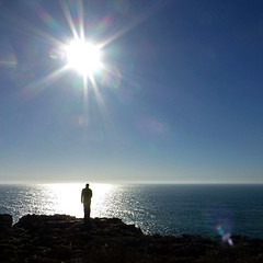 Panoramio and ipernity Refugee... (pom.angers) Tags: portugal europeanunion flare sea sun panasonicdmctz30 2014 march people fullsun man 100 200