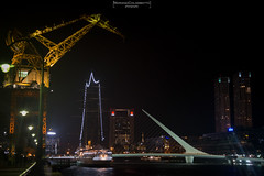 A view of Puerto Madero (Mariano Colombotto) Tags: puertomadero buenosaires argentina lights luces crane grua puentedelamujer bridge city ciudad fragatasarmiento ship water nikon edificios buildings autofocus infinitexposure