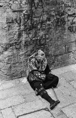 Old City Street Sitter (Warriorwriter) Tags: bw film monochrome analog temple israel alley palestine westbank muslim jerusalem middleeast domeoftherock christian jewish ilford israeli oldcity levant palestinian