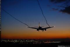 Jet Trails (zoomerphil) Tags: boeing 777 triple seven b777 jet airways plane airplane jetplane aeroplane fly flight approach finals landing vortex trails sunrise dawn blue orange london heathrow lhr egll