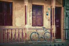 Bicycle On A Porch 3 (Artypixall) Tags: cuba baracoa porch bicycle windows door shutters house urbanscene faa