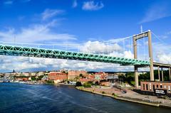 Arriving in Gteborg by ferry (jbdodane) Tags: alamy161016 bridge city cycletouring cyclotourisme europe freewheelycom goteborg sweden jbcyclingnordkapp alamy