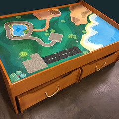 TOYS:  Rolling play table with storage.