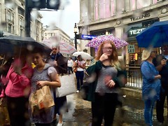 London Tales | The girl with the red hair (Nassia Kapa) Tags: nassiakapa londontales red girlwithredhair umbrella rain london bus takenfrominsideabus tube oxfordcircus