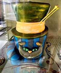 Grinning Cheshire Cat With Mad Hatter's Hat (chicbee04) Tags: arizona cakes hat tucson story bakery happybirthday grin grinning refrigerator friday madhatter aliceinwonderland comfortfood chesirecat lewiscarol nadinesbakery fridaymorningchallahrun