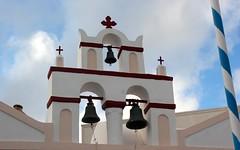 Steeple with bells (Nagarjun) Tags: blue sunset sun white church island volcano evening europe glow santorini caldera oia cyclades mediterranian firostefani aegeansea