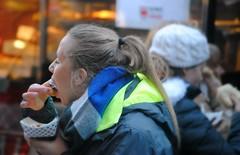 Enjoying the food at Christkindlmarket , Chicago (Cragin Spring) Tags: city people urban food woman usa chicago scarf fun illinois midwest holidays december unitedstates market coat unitedstatesofamerica chitown il daleycenter chicagoillinois chicagoil windycity daleyplaza christkindlmarket 2015