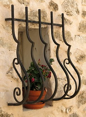 An elegant wiindow guard, Ampus, Var, Provence, France (Hunky Punk) Tags: ampus var provence window guard iron flower pot sill ledge wall stone france south