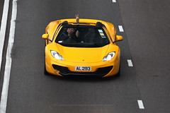 Mclaren, 12C Spider, Causeway Bay, Hong Kong (Daryl Chapman Photography) Tags: al293 mclaren 12c spider pan panning cwb causewaybay car cars auto autos automobile canon eos is ii 70200l f28 road engine power nice wheels rims hongkong china sar drive drivers driving fast grip photoshop cs6 windows darylchapman automotive photography hk hkg bhp horsepower brakes gas fuel petrol topgear headlights worldcars daryl chapman 1d mkiv