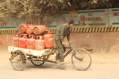 cooking gas (aviky2k) Tags: cooking gas cheaper costlier guy pulling rickshaw cylinders heavy red city urban rural capital metro business labour hardwork