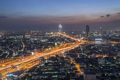 Drive into the sun (tapanuth) Tags: bangkok thailand expressway highway road traffic street infrastructure city cityscape urban bridge rama9 cable river crossing chaophraya kasikorn sunset sky bluehour twilight asia travel night nocturne scene view aerial skyscraper
