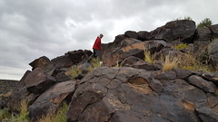 Fred climbing up the mesa to see the petroglyphs in Petroglyph NM