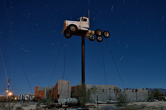 haulin' no more. yucca, az. 2015. (eyetwist) Tags: eyetwistkevinballuff eyetwist night dark yucca arizona route66 kenworth truck pole upintheair nikon d7000 nikkor 18200mmf3556gvr 18200mm mojavedesert mojave desert abandoned sign arid fullmoon longexposure long exposure startrails derelict moonlight roadside america americana route 66 mother road interstate 40 i40 moon rusty weathered sky stars roadtrip vintage whitingbros 18wheeler sixdaysontheroad elevated landmark southwest trucker trucking transport kingman american west post ruins repair bleak landscape industrial roadsideamerica