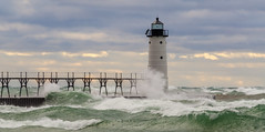 Walk Across Water (Aaron Springer) Tags: michigan northernmichigan lakemichigan thegreatlakes manisteenorthpierheadlight manisteelighthouse catwalk storm waves breakingwaves whitecaps nautical maritime november outdoor nature landscape seascape