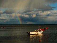 An autumn day on the beach of the Baltic Sea (Ostseetroll) Tags: deu deutschland geo:lat=5406182480 geo:lon=1076452540 geotagged ostseestrand schleswigholstein sierksdorf ostsee blt baltic sea fischerboot regenbogen rainbow
