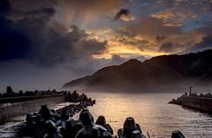 a lull in the rain (canon-Tom) Tags: sea seascape landscape sky clouds wharf port sun sunrise sunset sunlight rocks mountains nature travel rain water waves ocean canon taiwan taipei coast