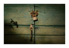 The lock of your heart (GP Camera) Tags: nikond80 tamronsp1750 door porta olddoor vecchiaporta lock serratura padlock lucchetto chain catena handle maniglia light luce shadows ombre lightandshadows lucieombre lighteffects effettidiluce textures trame wood legno abandoned abbandonato focus messaafuoco vignetting allaperto solitude solitudine details dettagli abstract astratto whiteframe cornicebianca italy italia piemonte monferrato darktable gimp opensource freesoftware softwarelibero digitalprocessing elaborazionedigitale