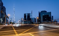 Dubai Downtown intersection (DavidGabis) Tags: crossroads intersection asia east abstract city panorama orange modern office iconic design business white landscape sunset dubai vector cityscape town sun urban silhouette construction house high bay line day background uae estate united traffic icon tall view night burj tower horizontal scene landmark emirates lights sky khalifa outdoor architecture building middle travel downtown exterior blue skyscraper skyline beautiful futuristic hotel black buildings tourism backgrounds arabic coast arab illustration nikon manfrotto d810