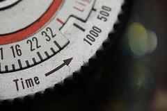 Time moves forward. (Neal.) Tags: macromondays macro arrow arrows lightmeter grandfather polaroid monday bokeh numbers camera canon picture photograph