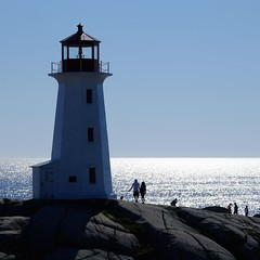 Record high (halifaxlight) Tags: ocean blue lighthouse canada square couple rocks novascotia silhouettes sunny visitors peggyscove sparkling shimmering
