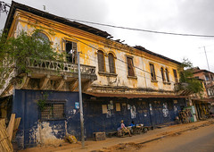 Benin, West Africa, Porto-Novo, old french colonial building (Eric Lafforgue) Tags: africa street old houses house color building history tourism horizontal architecture buildings french outside outdoors town day adult outdoor style facades westafrica afrika benin past 2people twopeople adultsonly colony touristattractions exteriors portonovo traveldestinations colonialstyle colourimage touristdestinations buildingexteriors adjac benin00268