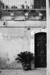 Modica, Sicily, Fall 2012 ({ sara }) Tags: door old urban blackandwhite italy house building architecture town europe italia antique balcony sicily sicilia biancoenero modica