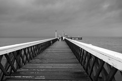 Yarmouth Pier on a Blustery Day (clive_metcalfe) Tags: isleofwhite yarmouth pier ocean cloudy windy boardwalk solent winter daylight people wood