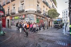 Students on the move. (f22photographie) Tags: streetscenes madridstreetscene students graffiti downtownmadrid cityscene citylife