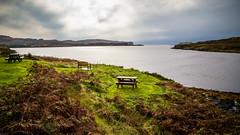 a place to sit (aprilpix) Tags: scotland isleofskye landscape bench water peace aprilpix
