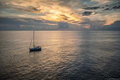The Solo Sailor (serbosca) Tags: manarola liguria italia it solo sailor sunset nikon d90 sergio boscaino seascape nature color boat