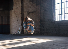 01 - Hiding (nikaylasnyder) Tags: levitation levitate float light windows abandoned building love jeans ripped flowy long hair fabric hiding darkness shadows shadow curious ecstasy jesus christ god catholic