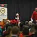 Tom Miller (left) listens as alumnus Andy Albright speaks at the annual General H. Hugh Shelton National Leadership Forum.