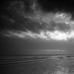 Winter sunset 1 (Andrew Malbon) Tags: leica leicam9 m9 southsea southseacommon solent portsmouth hampshire winter winterlight sunset sun saturday reflections shore shoreline sand clouds summilux 35mmf14 nd lee06ndsoftgrad leendgrad lee handheld rangefinder landscape seascape