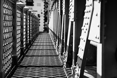 Crossing (marktmcn) Tags: lower eirw bridge trehafod rhondda road foot crossing structural engineer e taylor single span bow girder rivets riveted sunlight shadows blackandwhite monochrome d610 nikkor