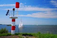 A day on the polders (neil mp) Tags: sea sky cloud lake holland netherlands yacht flag beacon flevoland ijsselmeer almere polders markermeer almerebuiten oostvaardersdijk oostvaardersdiep ijsselmeerpolders southernflevolandpolder