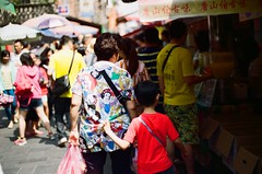 (Angelique Chuang) Tags: grandma shadow people sun film ariel shopping nikon princess grandmother market jasmine taiwan disney grandson taipei snowwhite rapunzel fm2 disneyprincess peoplescape