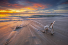Never Give Up .. (zakies) Tags: ocean longexposure sunset seascape rock sunrise island chair dramatic malaysia slowshutter strong sabah slowmotion labuan singleexposure sabahsunset zakiesphotography borneolanscape