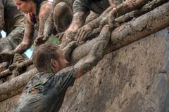 last hurdle 2 (stevefge) Tags: girls people netherlands sport climb mud nederland run event viking hurdles helping strongviking