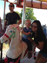 """Paul Rides the Carousel with Aunt Emily • <a style=""""font-size:0.8em;"""" href=""""http://www.flickr.com/photos/109120354@N07/22830629547/"""" target=""""_blank"""">View on Flickr</a>"""