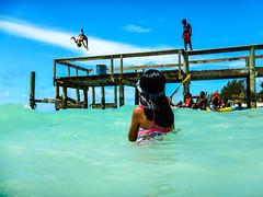 kids having fun (-gregg-) Tags: bahamas flip pier water ocean kids clouds sky