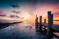 Epic Sunrise! (Anthony Malefijt - www.malefijtfotografie.nl) Tags: holland nederland texel sunrise sun sky clouds zon zonsopkomst serene beautiful orange jetty reflection colors landscape nikon wwwmalefijtfotografienl
