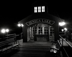 Pier at Seneca's South End (LJS74) Tags: fingerlakes dock harbor fisherman monochrome bw blackandwhite night pier watkinsglen senecalake
