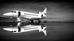 Falcon 7X Reflection. (spencer.wilmot) Tags: aviation falcon7x dassault bizjet businessjet corporatejet private privatejet blackandwhite monochrome reflections water puddles clouds steps trijet winglets plane airplane aircraft airport airside apron ramp ngelholm agh esta jet composite