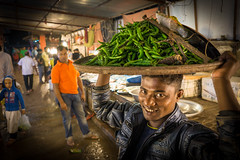 You want veggies? (herr_muenchen) Tags: a6000 bangladesch bangladesh city dhaka flughafengegend kalender markt nacht sdasien treiben highiso boy veggie streetphotography