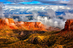 WHIRLING AND TWIRLING (Aspenbreeze) Tags: colorado coloradonationalmonument fog clouds mist groundfog lowclouds spires rockformations redrockformations nature sky rain rural outdoors grandjunctioncolorado bevzuerlein aspenbreeze moonandbackphotography