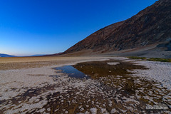 Salt Pool Moonlight (kevin-palmer) Tags: deathvalley deathvalleynationalpark nationalpark california mojavedesert badwaterbasin saltflats salty hot clear blue sky evening nikond750 november fall autumn tokina1628mmf28 water pool reflection mountains twlight moonlight moonlit