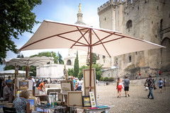 Avignon - working for tourists (Rafael Zenon Wagner) Tags: travel people pope france tower castle art church colors work 35mm watercolor nikon frankreich dof bokeh dom platz picture kirche sigma medieval menschen parasol provence avignon arbeit fortress burg reise farben papst festung schirm squere provençal d810