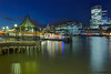 London Bridge Pier (Aubrey Stoll) Tags: uk longexposure windows england money bus london tower water thames night reflections londonbridge river pier sticks construction commerce colours shadows capital shed cranes gb posts cityoflondon finance walkie talkie squaremile