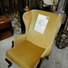 Green fabric wing back armchair