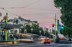 3rd at 23rd street platform (pbo31) Tags: sanfrancisco california street november urban motion color green fall nikon traffic platform tram motionblur muni 3rdstreet dogpatch roadway 2015 lightstream boury pbo31 d810